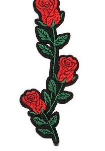Tygmärke att stryka på plagg röda rosor