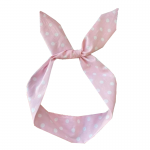 Rosa hårband med vita prickar