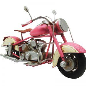 nostalgi rosa motorcykel i plåt