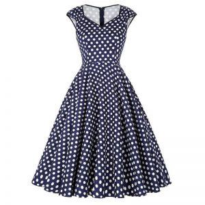 Marinblå klänning vita prickar