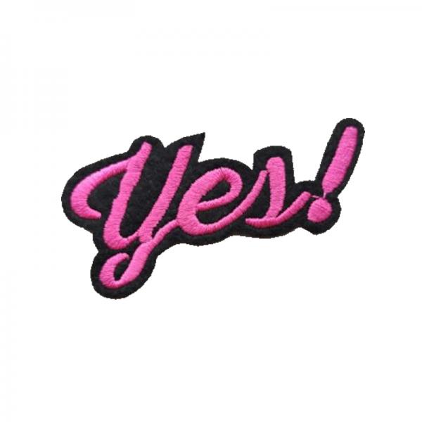Tygmärke rosa yes