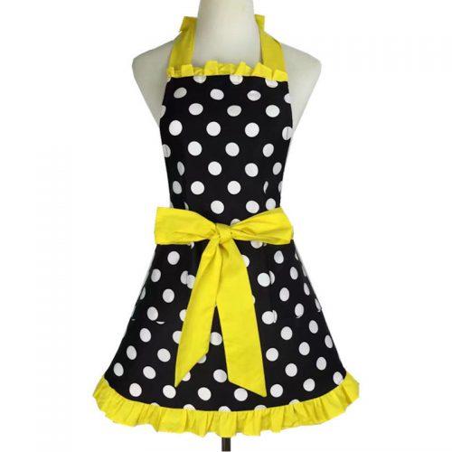 Prickigt förkläde svart gul volang 50 tal retro
